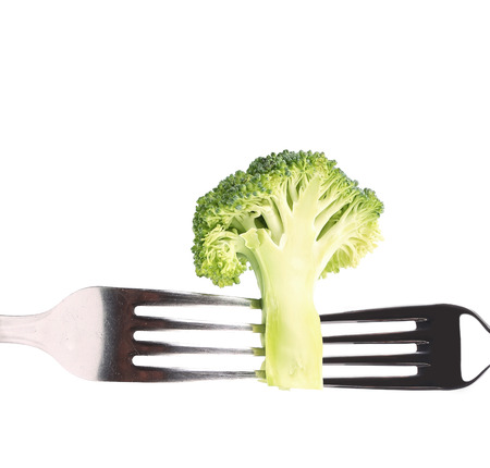 Photo of broccoli on a forks. Isolated on a white background. photo