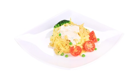 Pasta with dressing and green beans. Isolated on a white background. photo