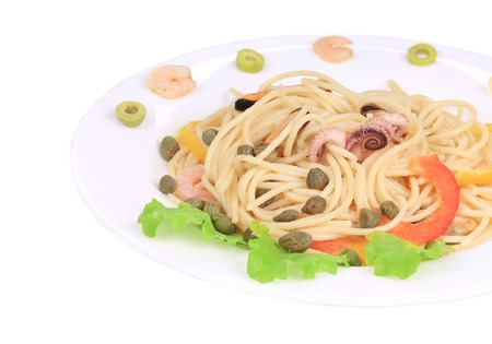 Seafood salad with spaghetti. Isolated on a white background. photo