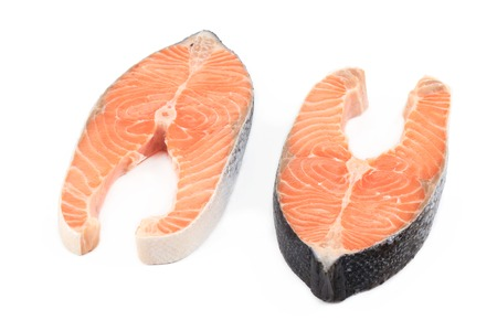 Fresh salmon steaks. Isolated on a white background. photo
