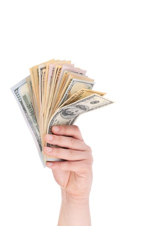 Man hand with dollars. Isolated on a white background. photo
