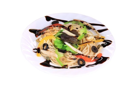 Seafood salad with spaghetti. Isolated on a white . photo