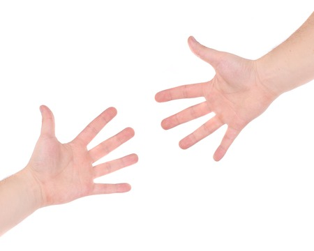 Two hand reaching each other. Isolated on a white background. photo