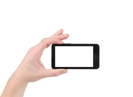 Hand holds cell phone with clipping path. Isolated on a white background. photo