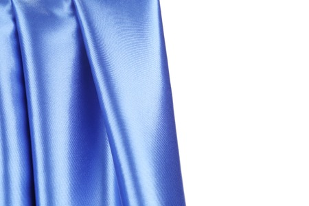 Creases in blue fabric. Place for text. Whole background. photo