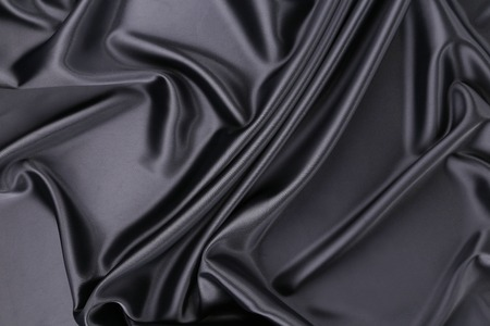 Black silk background. Texture. Close up. Whole background. photo