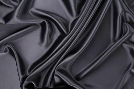 Black silk background. Texture. Close up. Whole background. photo