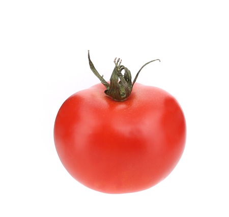Close up of fresh tomato. Isolated on a white background.