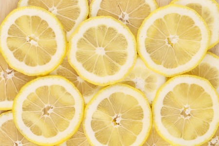 Close up of lemon slices. Macro. Whole background. photo