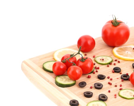 Composition of vegetables on wooden platter. Whole background. photo