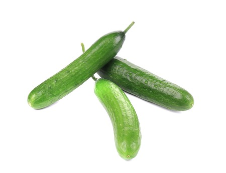 Three fresh cucumbers. Isolated on a white background. photo