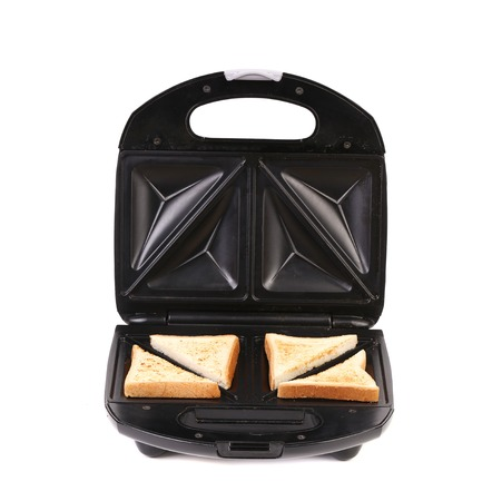 quick snack: Sandwich maker with bread. Isolated on a white background. Stock Photo