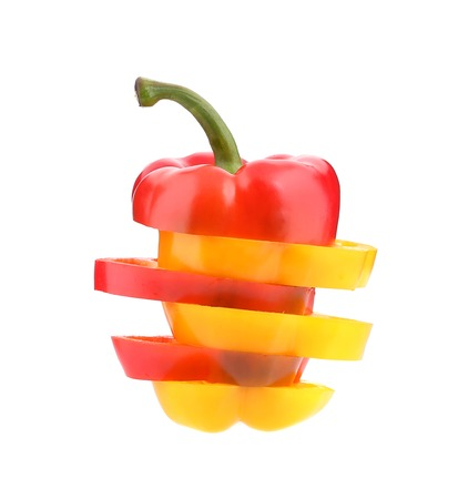 Multi-colour slices of peppers. Isolated on a white background. photo
