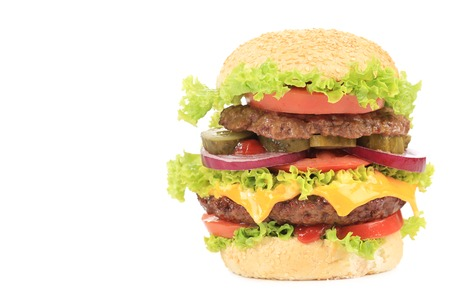Big appetizing hamburger. Isolated on a white background. photo