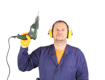 Worker standing with green drill.  Isolated on a white background. photo