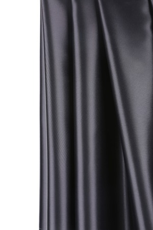 creases: Creases in black fabric. Close up. Whole background. Stock Photo