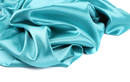 Soft folds and highlights of light blue silk. Whole background. photo