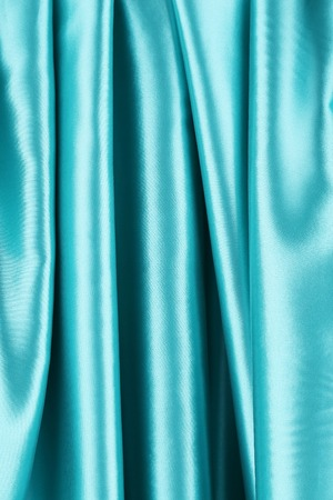 Creases in blue fabric. Close up. Whole background. photo