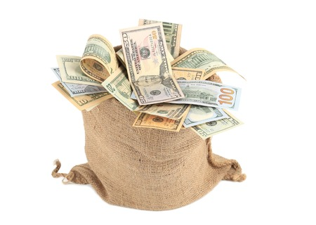 Full sack with dollar bills. Isolated on a white background. photo
