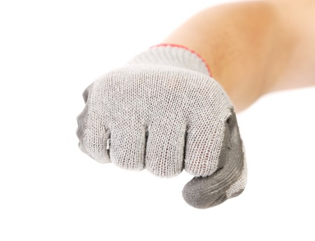 Strong male worker hand glove clenching fist. Isolated on a white background. photo