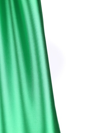 creases: Creases in green fabric. Close up. Whole background.
