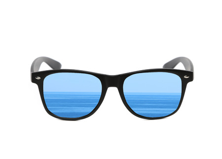 Sunglasses with sea reflection  Isolated on a white background  Stock Photo