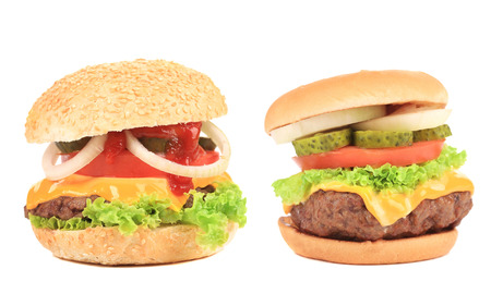 Close up of two tasty hamburgers  Isolated on a white background  photo