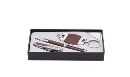 Pen and trinket in a box. Isolated on a white background. photo