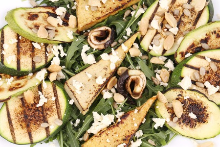Salad with grilled vegetables and tofu. Whole background. photo