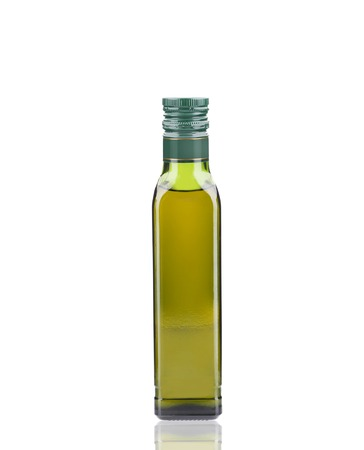 Glass bottle of olive oil. Isolated on a white background. photo