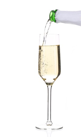 Champagne pouring in a glass. Isolated on a white background. photo