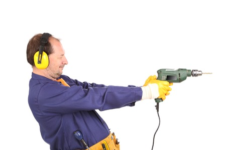 Worker in ear muffs and glasses with drill. Isolated on a white background. photo