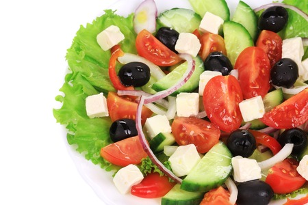 Greek salad. Isolated on a white background. photo