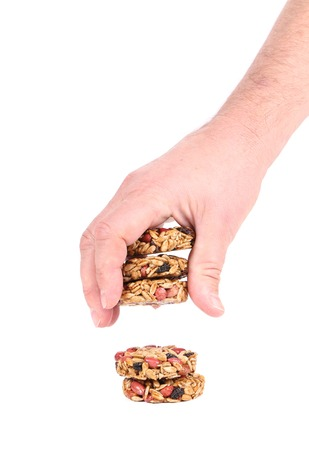 Hand holds candied peanuts sunflower seeds. Isolated on a white background. photo