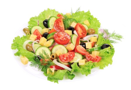 Greek salad with cheese. Isolated on a white background. photo