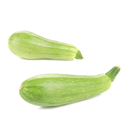 Two ripe zucchini. Isolated on a white background. photo