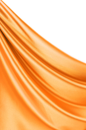 Golden satin. Located on a white background. photo