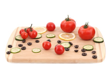 Composition of tomatoes and olives. Isolated on a white background. photo