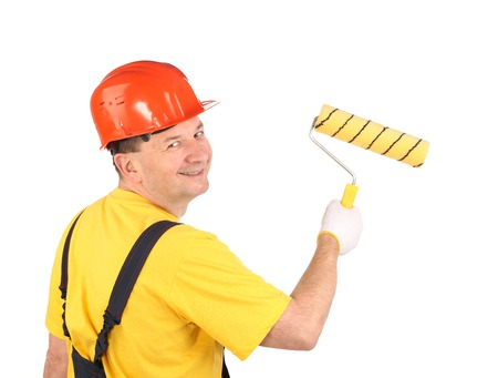 Worker with roller and bucket. Isolated on a white background. photo