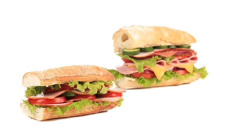 Two appetizing sandwiches with cheese. Isolated on a white background. photo