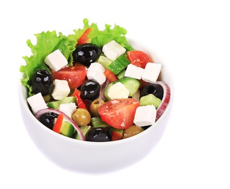 Fresh greek salad. Isolated on a white background. photo