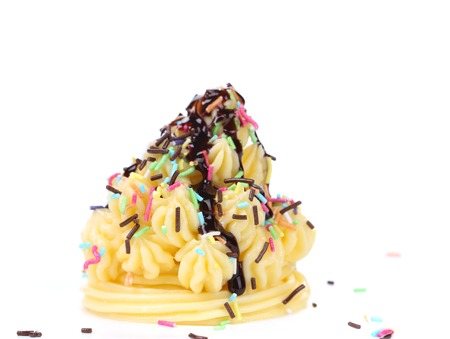 Cake topped with sprinkles. Isolated on a white background. photo