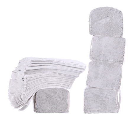 Stack of folded disposable papers. Isolated on a white background. photo