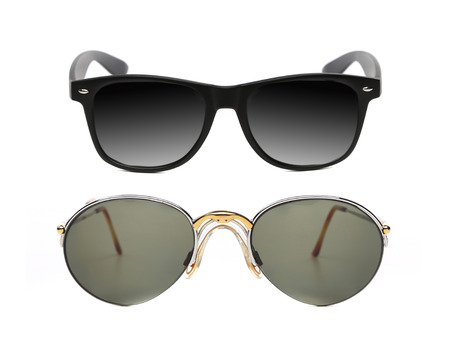 Two pair of fashionable sunglasses. Isolated on a white background. Stock Photo - 27444700