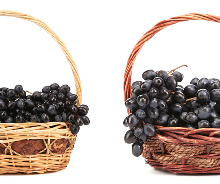 Two basket with red grape. Isolated on a white background. photo