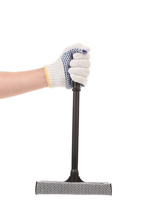Hand holds squeegee for windows. Isolated on a white background. photo