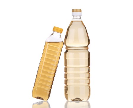 Two bottles of vinegar. Isolated on a white background. photo