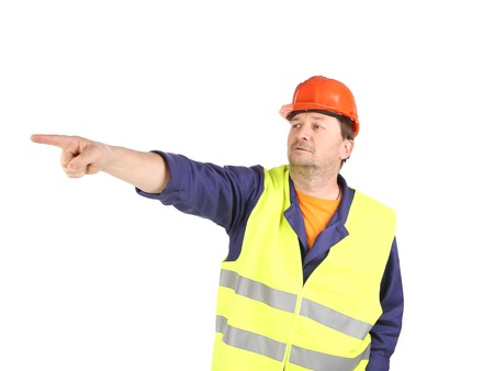 Worker in reflective waistcoat point the finger   Isolated on a white background  Stock Photo