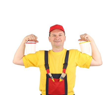 Strong man in working clothes  Isolated on a white background  photo