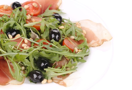Salad with arugula and prosciutto. Whole background. photo